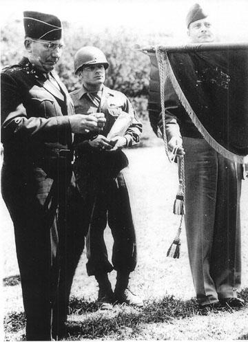 BG Harris places PUC streamer on 254th Regimental Flag-1945