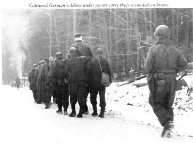 German POWs being escorted to the rear.