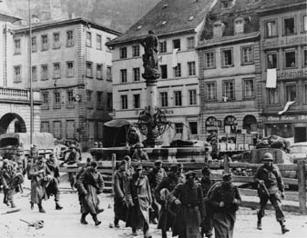 US Troops leading German POWs through Heidelberg, 1945