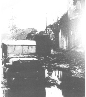 Jeep moves through Jebsheim after the Battle