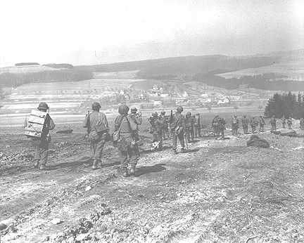 254th troops moving into Eschningen, Germany 15 Mar 45