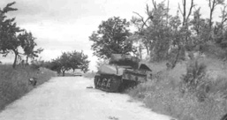 American armor destroyed by enemy fire.