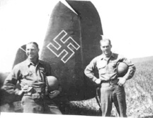 D/255th Inf personnel with German aircraft