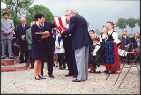 Angelo Christopher D/254th presents flag to Mayor of Jebsheim France 2000