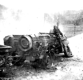 863d FA Bn Jeep hit by enemy fire- Germany 1945