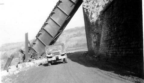 Wire team checking wire near destroyed bridge- Germany 1945