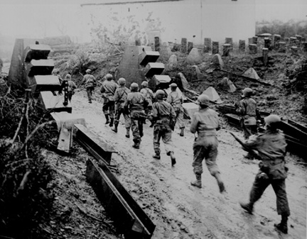 US forces move through break in Siegfried Line- Mar 45