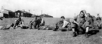 H/253d troops taking  a break Cp Van Dorn MS 1944