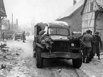 Ambulance transport dead soldiers from Jebsheim, France Jan 45