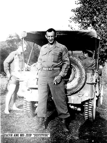 Zacur, B Btry 863d FA Bn with his jeep- 1943