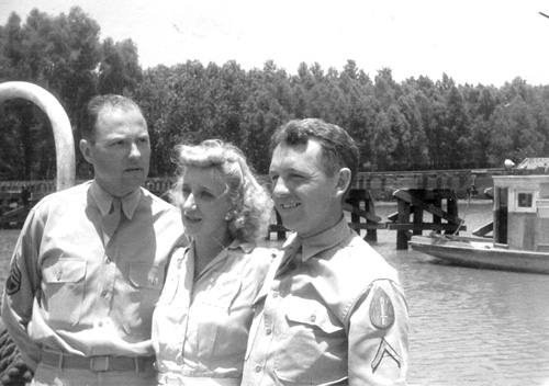 63d Band members and a spouse cross the Mississippi River-1944