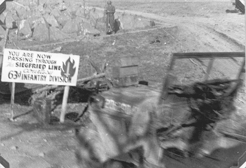 63d Inf Div sign leading through the Siegfried Line- 1945