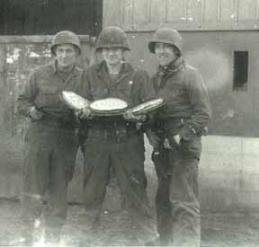 Hq Co 254th troops with homemade pies- Rexigen, France