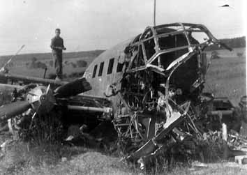 Jacobus, Hq 254th Inf and wrecked German aircraft- 1945