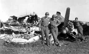 Hq 254th Inf troops and German aircraft- 1945